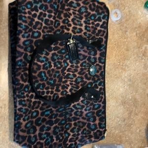 Leopard Coach overnight bag with makeup case